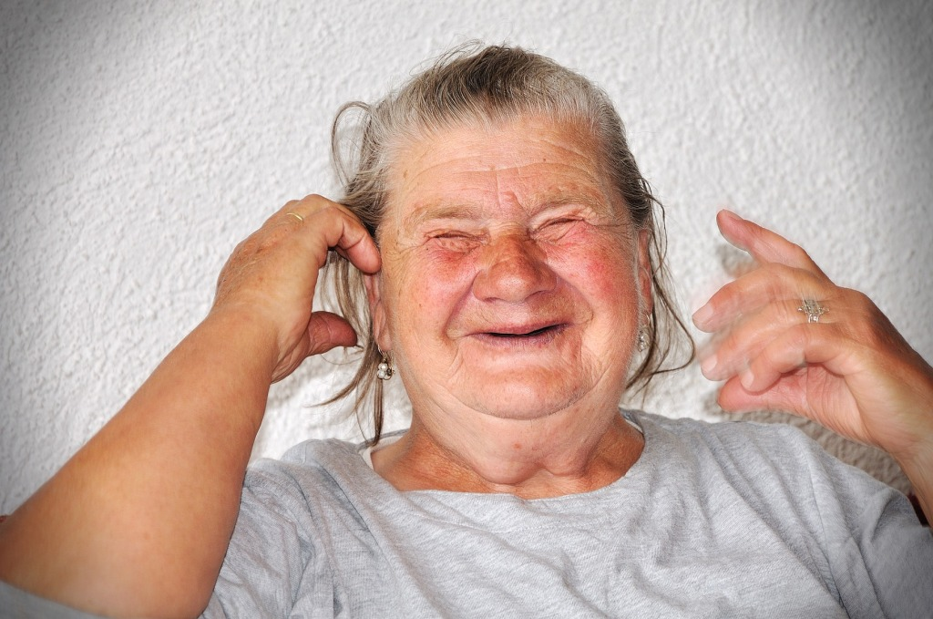 Old elderly woman with funny goody face